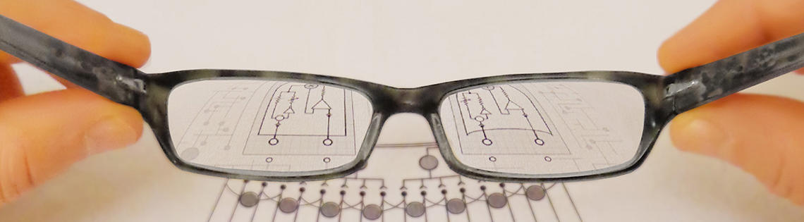 Image of eyeglasses magnifying a diagram.