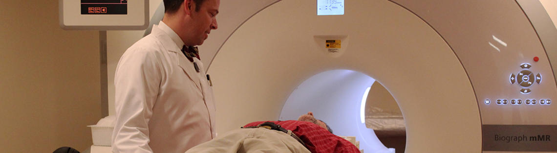 Technologist talks to patient in a scanner.