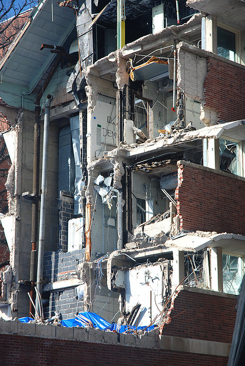 Exposed face of partially flattened building