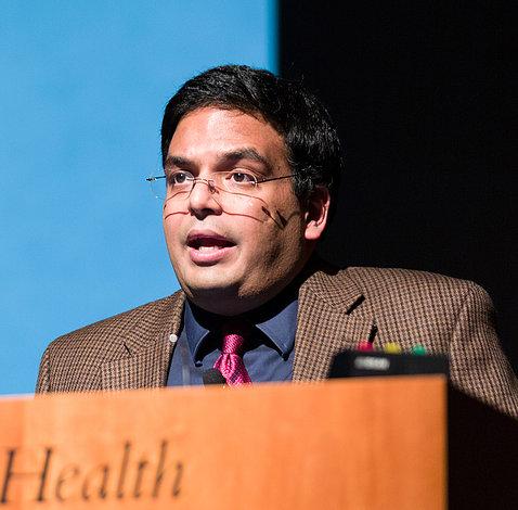 Dr. Jain speaks at podium.