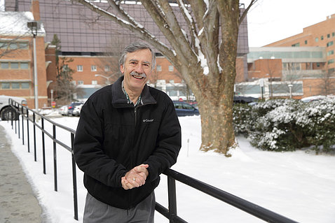 Mueller, with snow covered NIH grounds behind him