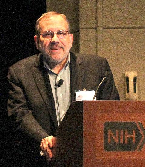 Sanes behind NIH podium