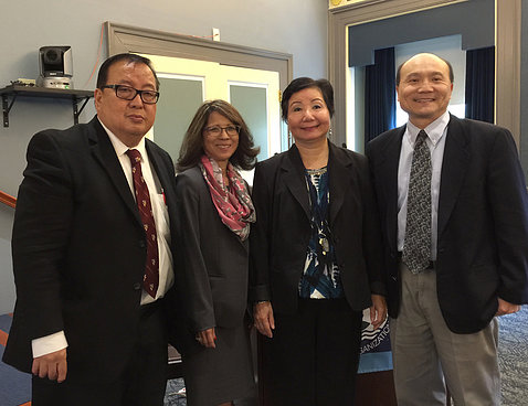 Four members of APAO panel pose for a photo.