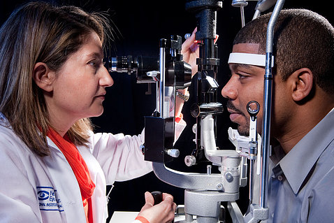 A doctor screens a patient for vision loss