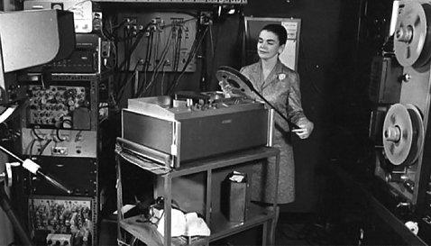 Benschoter inspects a film reel