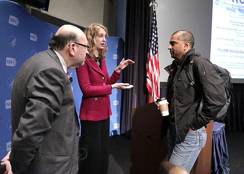 Rudorfer and Lisanby chat with an attendee