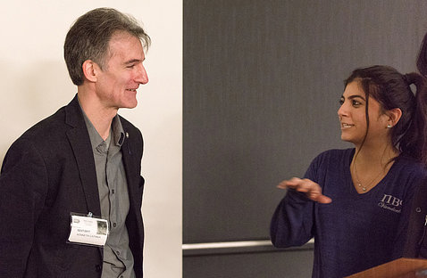 Catania chats with attendee after lecture