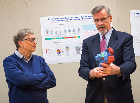 Gates and Graham look at 3-D model of flu virus.