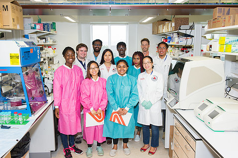 Students and staff in the lab