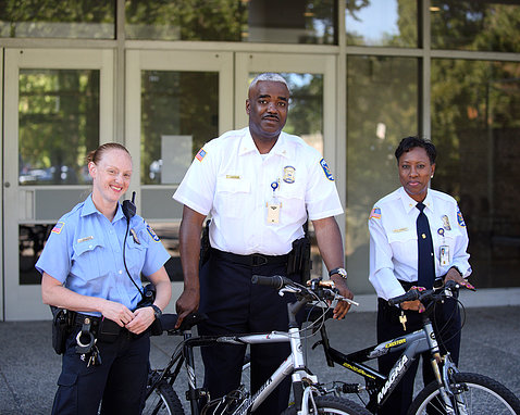 Police officers with donated bikes