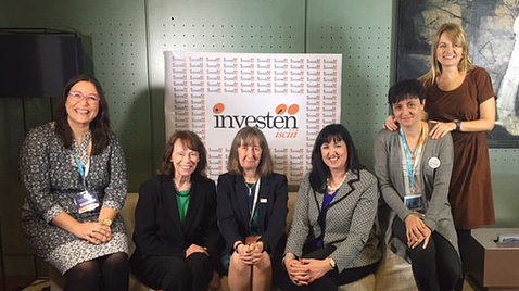 NINR director Dr. Patricia Grady seated with colleagues in front of investen sign