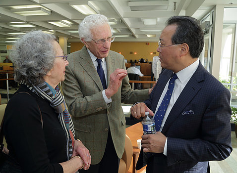 Yo-Yo Ma interacts with two audience members