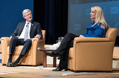 Rubins and Collins chat, seated on stage in Masur Auditorium.