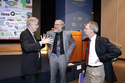 Drs. Church, Collins and Green confer before the lecture.
