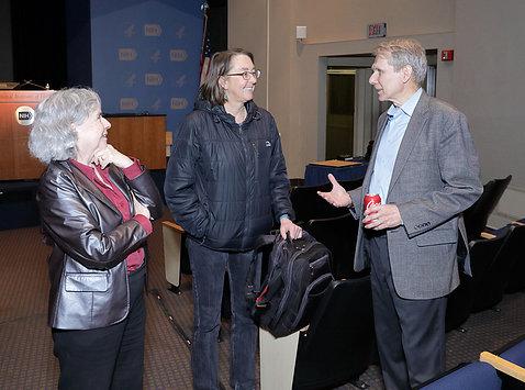 Dr. Lewis greets NIH scientists.