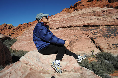 Branson sits on a rock