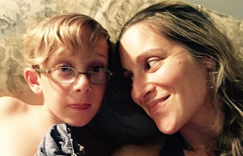 Carly Israel-Agin smiles at her son