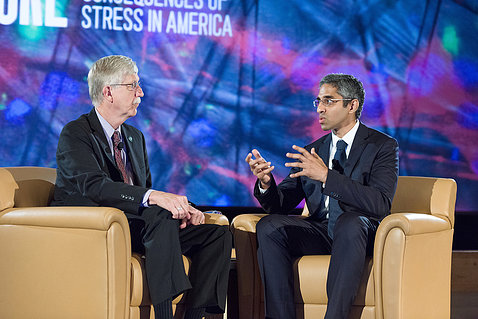 Drs. Murthy and Collins, seated onstage