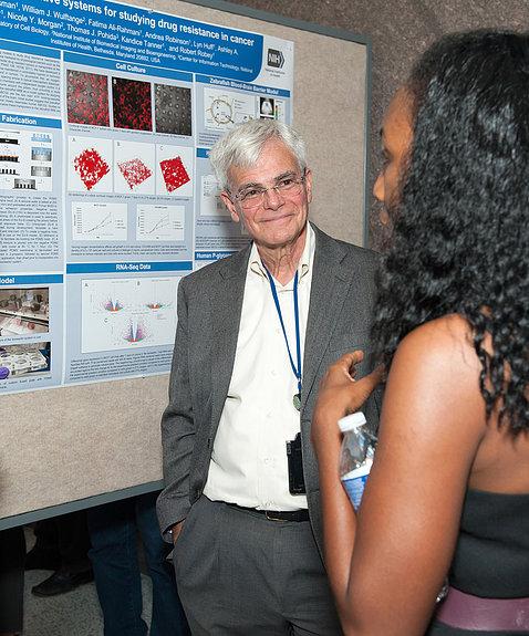 Gottesman smiles as Tanner explains her poster