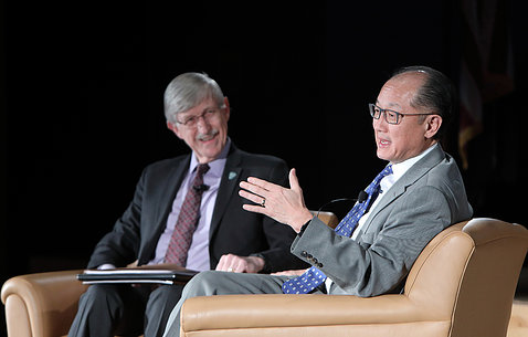 Dr. Jim Yong Kim onstage with Dr. Collins