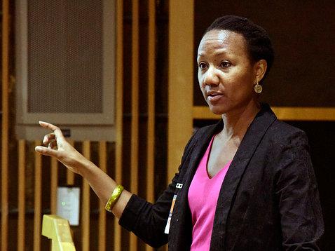 Dr. Sherilynn Black speaks at the podium.