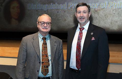 Peter Leeds greets guest lecturer Moreland.