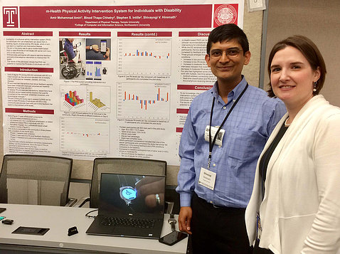 NICHD's Dr. Theresa Cruz visits a poster presented by Temple University's Shivayogi Hiremath.