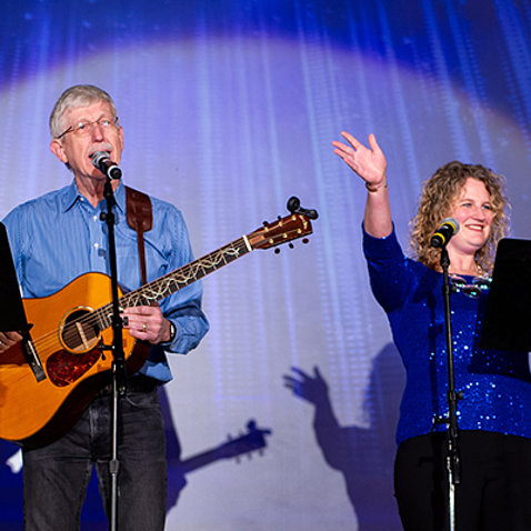Dr. Collins and Dr. Wolinetz sing