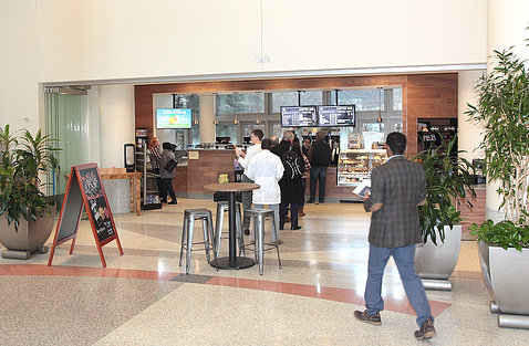 People checking out the new Starbucks Marketplace in the CRC atrium