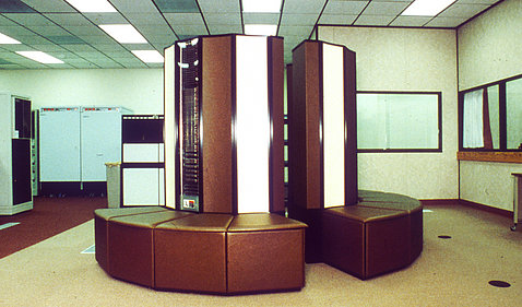 The massive Cray X-MP supercomputer surrounded by benches, used in the late '80s.