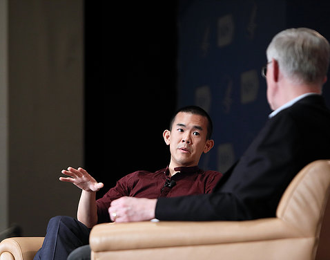 Author Ed Yong on stage with NIH director Dr. Francis Collins at the Big Read event