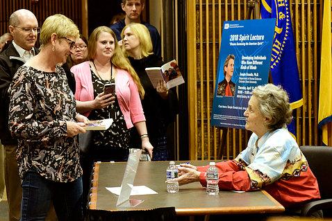 Grandin signs books/