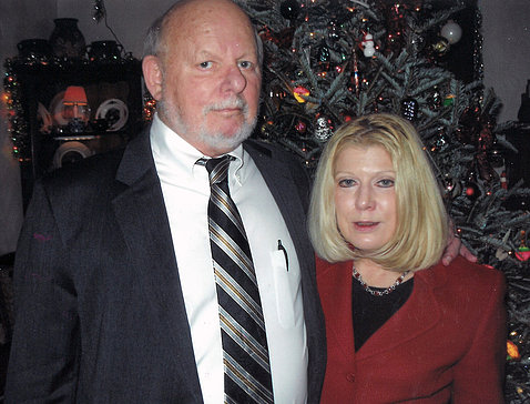 Dr. Guadagno and husband Dr. Micklin in front of their Christmas tree