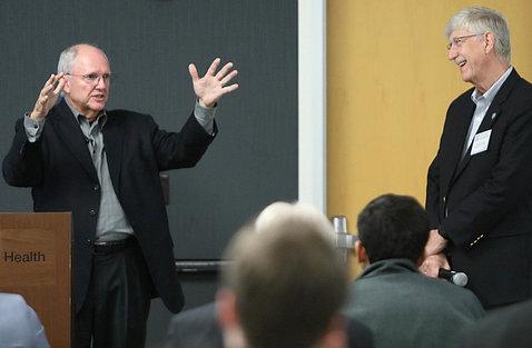 Craig Mundie speaks at the workshop as Dr. Collins looks on.