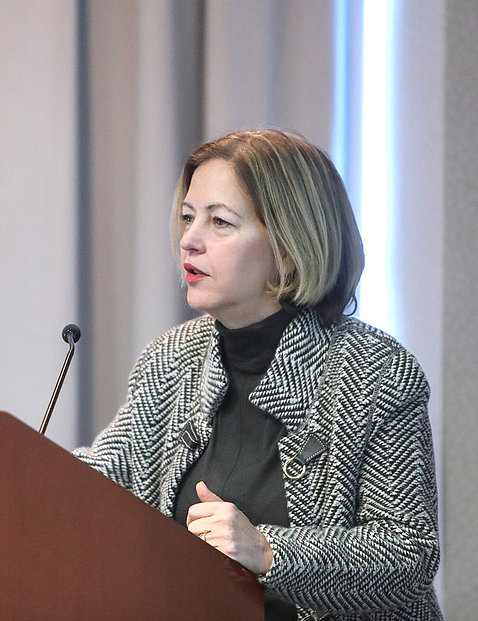 Dr. Alegría speaks at a podium