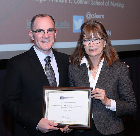 Dr. Lee holds plaque he received from NINR acting director Dr. Cashion, also pictured