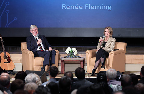 Collins and Fleming speak on stage