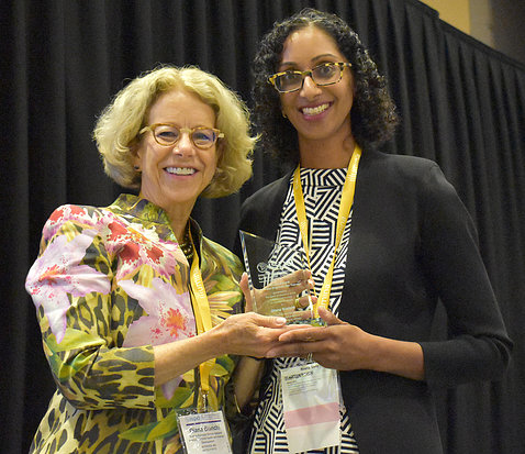 Bianchi holds her award, posing with Dr. Vora