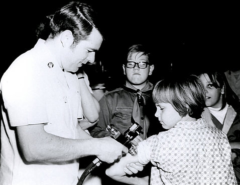 Doctor gives a vaccine shot to a child