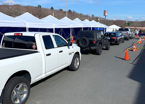 Cars form a line as people wait to get tested at a Covid-19 testing site in Massachusetts.