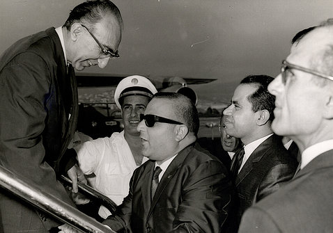 Archival photo shows DeBakey exiting a plane, greeted by Lebanese officials.