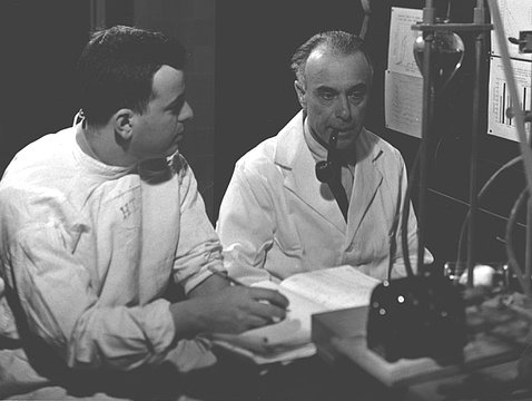 A black-and-white photo show Tabor and Rosenthal in their lab.