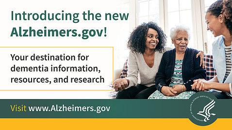 Two women hug a grey-haired older woman on a poster that reads: Introducing the new Alzheimers.gov