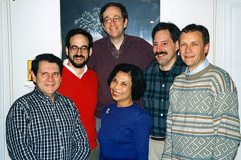 Group of people smiling into camera