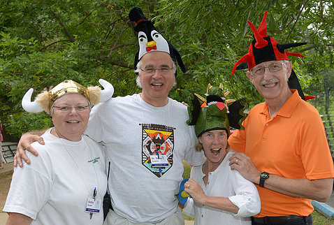 Kathy Russell, Chanock, Diane Baker and Dr. Collins all wearing festive hats at Camp Fantastic event