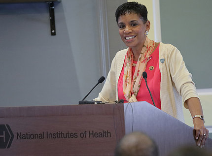 Rep. Donna Edwards stands at a podium
