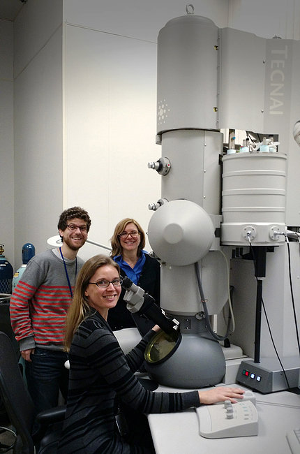 Scientists seated at cryo-EM microscope