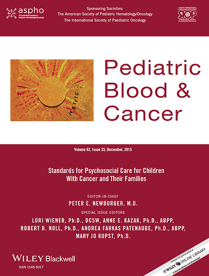 """Red and yellow book cover titled, """"Pediatric Blood & Cancer"""""""