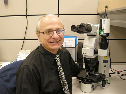 Brosky sit next a microscope