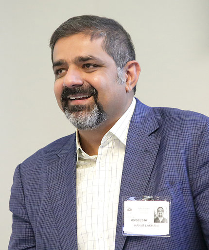 Dr. Karim Lakhani speaks at podium